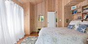 Master bedroom in Fair Harbor summer home for sale